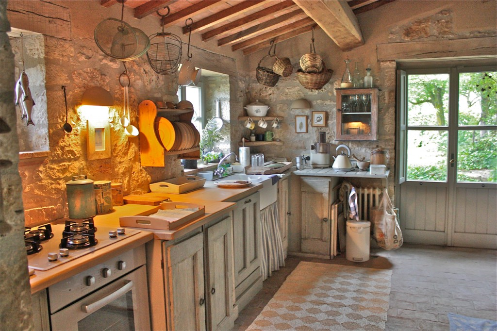Don't you love the stone walls and floors of this kitchen? They immediately  give it a sense of age and history.