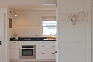 into the kitchen - Maine cottage by Sheila Narusawa architects