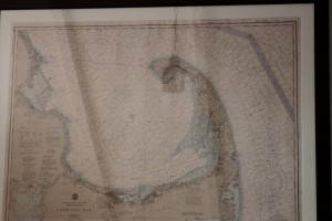 iew from the bed: ship's lantern reflected on map of Cape Cod