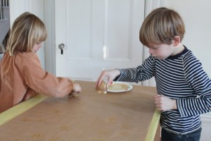 Olie and Soliv making potato stamp wrapping paper