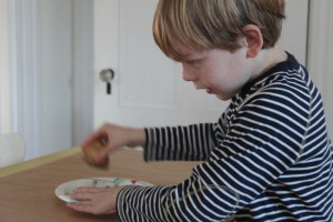 Olie making potato stamp wrapping paper