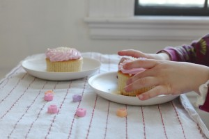 reaching for a cupcake