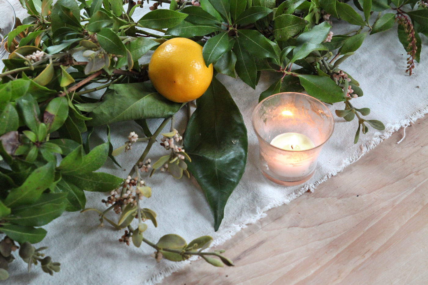 mistletoe meyer lemon garland, finished with candles 3, by Justine Hand for Remodelista